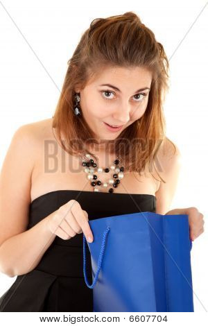 Surprised Beautiful Women With Paper Bag