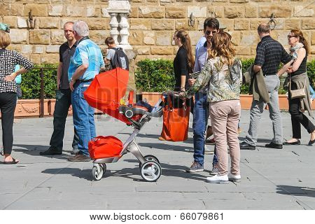 Young Family Walking In A Summer Town. Florence, Italy