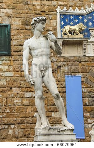 Statue of Michelangelo's David front of the museum Palazzo Vecchio . Florence Italy