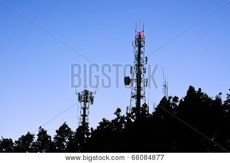 Silhouette Of Stanchion Phone Tower Signals On Blue Sky