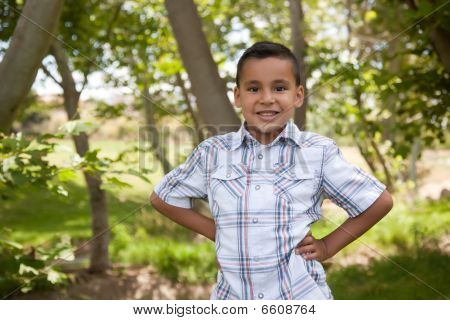 Handsome Young Hispanic Boy In The Park
