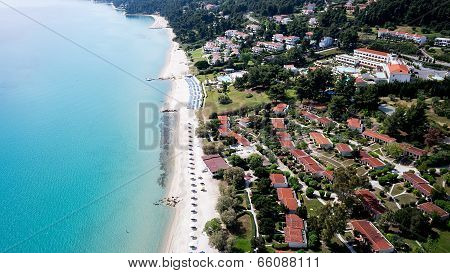 Top View Of Beach With Tourists, Sunbeds And Umbrellas At A Luxury Hotel. Sea Travel Destination In