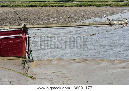 Bow of red boat with anchor