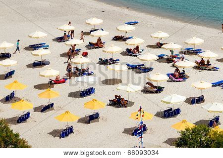 Beach With Tourists, Sun Beds And Umbrellas. Expected To Be The Best Sea Travel Destination. Top Vie