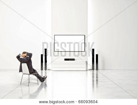 Businessman watching home cinema