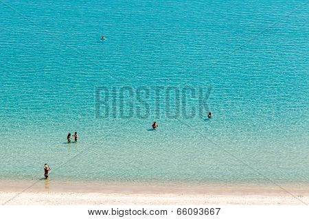 Beach With Tourists, Swimming And Enjoying It. Expected To Be The Best Sea Travel Destination. Top V