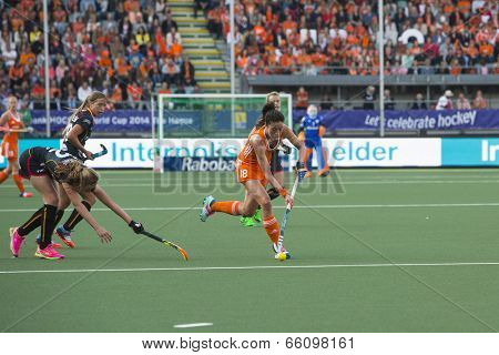 THE HAGUE, NETHERLANDS - JUNE 2: Dutch van As is passing the Belgium defense of the Belgium team during the Hockey World Cup 2014 NED beats BEL 4-0