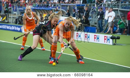 THE HAGUE, NETHERLANDS - JUNE 2: Dutch Maasakker is is playing the ball when Belgium player Boon is trying to take over the ball. During the Hockey World Cup NED beats BEL 4-0