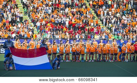 THE HAGUE, NETHERLANDS - JUNE 2 2014: Line-up of the Dutch team with the Dutch flag before the match The Netherlands - Belgium during the Hockey World Cup 2014 NED beats BEL 4-0