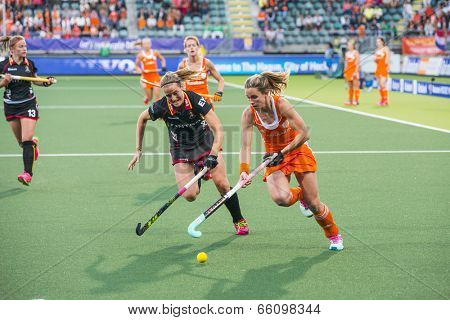 THE HAGUE, NETHERLANDS - JUNE 2: Dutch Hoog is lifting her stick to control the ball, Belgium player de Groof is trying to take over the ball during the Hockey World Cup 2014 NED beats BEL 4-0
