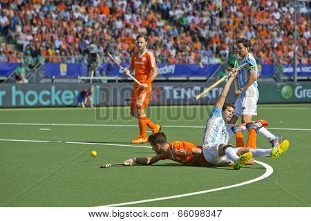 THE HAGUE, NETHERLANDS - JUNE 1 2014: Argentinian Defender Lopez commits a foul on Dutch player Kemperman during the World Cup Hockey, resulting in a penalty corner.  appeal is useless. NED beats ARG 3-1
