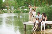 image of fishing rod  - Young happy family with kids fishing in pond in summer - JPG