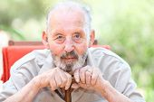 stock photo of cataract  - happy senior with cataracts in eyes - JPG