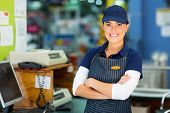 picture of cashiers  - happy female hardware store cashier with arms folded - JPG
