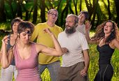 picture of fellowship  - A group of practitioners of yoga dancing emotional outdoor - JPG