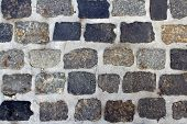 stock photo of cobblestone  - Spotted cobblestone and cement background for design - JPG