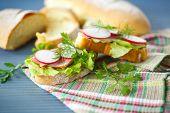 stock photo of radish  - sandwich with lettuce ham and radish for breakfast - JPG