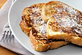 stock photo of french toast  - Plate of French Toast with powdered sugar - JPG