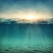 stock photo of deep  - Abstract underwater background with sunbeams - JPG