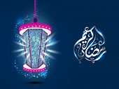foto of kareem  - Hanging colorful lantern and arabic islamic calligraphy of text Ramadan Kareem on blue background for for holy month of muslim community Ramadan Kareem - JPG