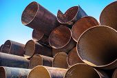 stock photo of orifice  - Lots of rusty metal pipes put together - JPG