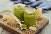 pic of pesto sauce  - Fresh made Pesto Sauce in glass jar on wooden background - JPG