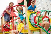 stock photo of playground  - Image of joyful friends having fun on playground outdoors  - JPG
