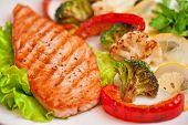 stock photo of salmon steak  - Tasty dish of salmon steak with vegetables - JPG