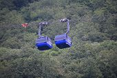 stock photo of ropeway  - Two ropeway cabins next to eaxh other in the summer - JPG