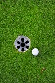 image of caddy  - Golf ball and golf hole on the green grass - JPG