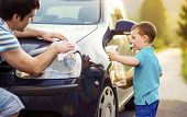 image of father time  - Young father with his little son washing car - JPG