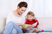 picture of babysitter  - Mother reading book with her child horizontal - JPG