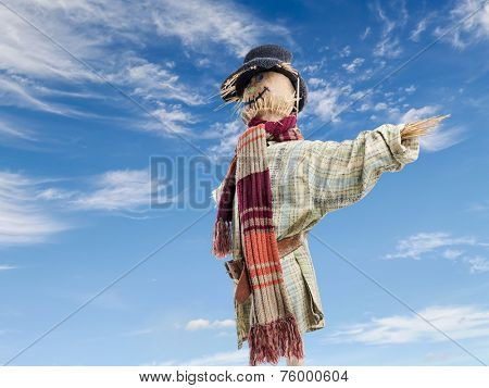 Scarecrow against the blue sky