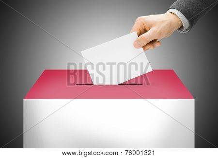 Voting Concept - Ballot Box Painted Into National Flag Colors - Monaco