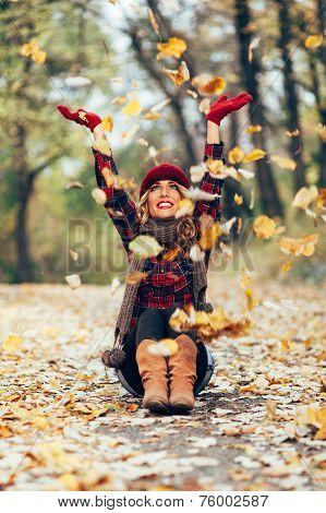 Beautiful Blonde Throwing Leaves In The Air