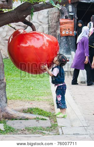 Bangkok, Thailand - January 31 : Unidentified Girl Try To Eat Toy-apple On January 31 , 2009
