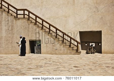 A couple in the Nizwa Fort Castle