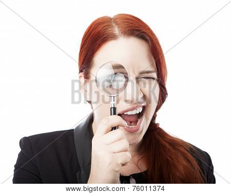 Pretty Businesswoman Spying With Magnifying Glass