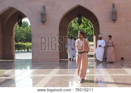 An Arab Man Walking At The Sultan Qaboos