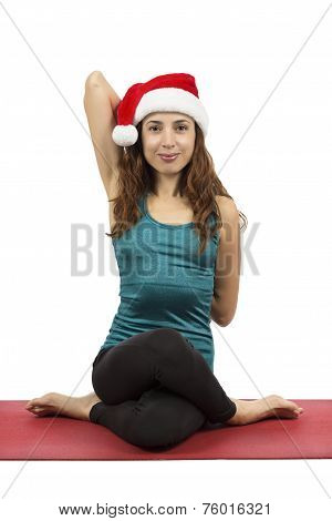 Christmas Woman Doing Cow Face Pose In Yoga