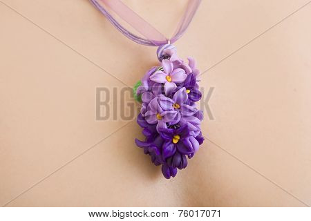 Romantic Style: Fashion Studio Shot Of A Floral Lilac Necklace (jewelery Made Of Polymer Clay)