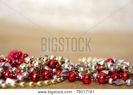 Red And Gold Beaded Necklaces Frame Gold Glitter Background