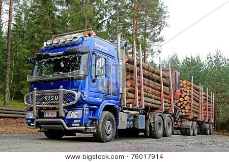 Blue Sisu Polar Timber Truck Hauls Spruce Logs