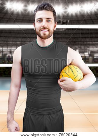 Volleyball player on gray uniform on volleyball court.