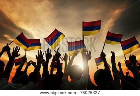 Group of People Waving Armenian Flags in Back Lit