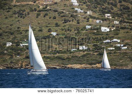 Sailboats trip on sea in Greece. Luxury yachts, sea voyages.