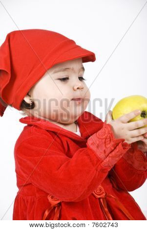 Baby Girl Holding An Apple