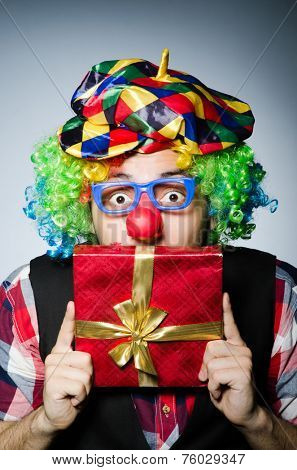 Funny clown with red giftbox