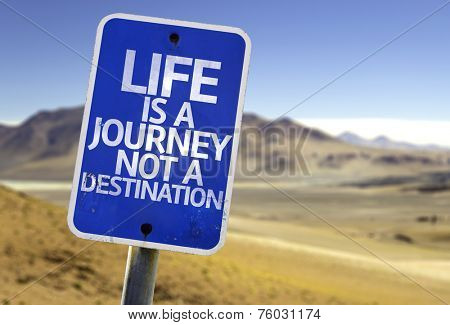 Life is a Journey not a Destination sign with a desert background