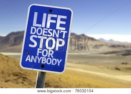 Life Doesn't Stop for Anybody sign with a desert background